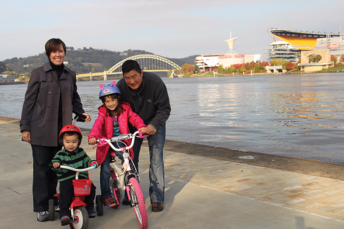 Family on Point State Park promenade with kids on bikes - photo by Alan Whittington